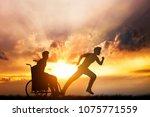 disabled man in a wheelchair...   Shutterstock . vector #1075771559