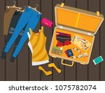 packed suitcase for summer... | Shutterstock .eps vector #1075782074