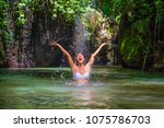 attractive happy white tourist... | Shutterstock . vector #1075786703