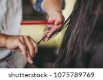 hand of the person who is... | Shutterstock . vector #1075789769