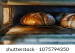 fresh buns from the oven.... | Shutterstock . vector #1075794350