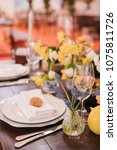 easter table set in yellow... | Shutterstock . vector #1075811726