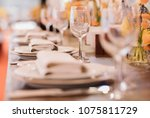 served dinner table in a... | Shutterstock . vector #1075811729