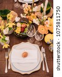 easter table set in yellow... | Shutterstock . vector #1075811750