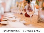 served dinner table in a... | Shutterstock . vector #1075811759