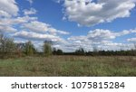 spring landscape with field and ... | Shutterstock . vector #1075815284