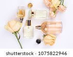 perfume bottles surrounded by... | Shutterstock . vector #1075822946