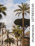 palm trees and white building... | Shutterstock . vector #1075833140