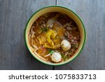 spicy noodle soup with pork ... | Shutterstock . vector #1075833713