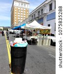 Small photo of HOLLYWOOD, Los Angeles, California - April 8, 2018: Hollywood Farmers' Market on Ivar Ave. and Selma Avenue, Full Trash Can
