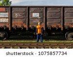 railway worker in overalls with ... | Shutterstock . vector #1075857734