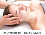 masseur doing massage on face... | Shutterstock . vector #1075863206