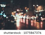 blurred city at night. bokeh.... | Shutterstock . vector #1075867376