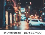 blurred city at night. bokeh.... | Shutterstock . vector #1075867400