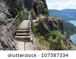 foot bridge in mountains over sea - stock photo