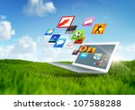 Green Technology - A notebook with various software applications - stock photo