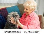 Beautiful Senior Lady Pats Her...