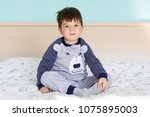 portrait of adorable small kid... | Shutterstock . vector #1075895003