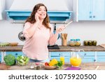 young overweight woman with... | Shutterstock . vector #1075920500
