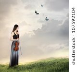 Violin Player on a Mountain Top (with butterflies) - stock photo