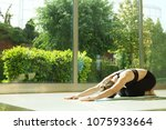 attractive sporty young yogi... | Shutterstock . vector #1075933664