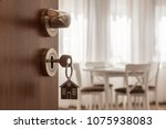 open door to a new home. door... | Shutterstock . vector #1075938083
