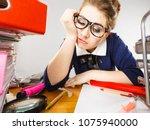 sleepy business woman doing her ... | Shutterstock . vector #1075940000