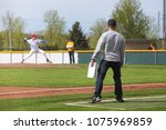 baseball coach standing at... | Shutterstock . vector #1075969859