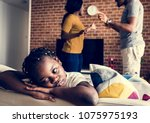 daughter sad while her dad and... | Shutterstock . vector #1075975193