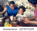 black family eating healthy... | Shutterstock . vector #1075975199
