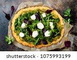 cauliflower pizza crust with... | Shutterstock . vector #1075993199