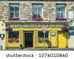 an irish bar exterior  taken at ... | Shutterstock . vector #1076010860