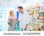 male pharmacist serving a... | Shutterstock . vector #1076039993