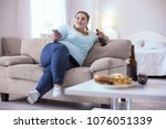 bad nutrition. stout red head...   Shutterstock . vector #1076051339