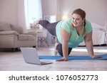 video lesson. obese young woman ...   Shutterstock . vector #1076052773