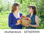 happy girls with apples harvest ... | Shutterstock . vector #107605544