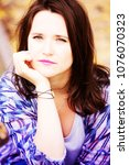portrait of beautiful brunette... | Shutterstock . vector #1076070323