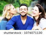 two beautiful women kissing... | Shutterstock . vector #1076071130