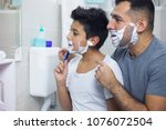 father is teaching his son to... | Shutterstock . vector #1076072504