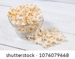 popcorn in galss bowl on white... | Shutterstock . vector #1076079668