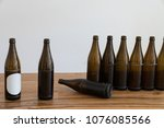 many empty beer bottles on a... | Shutterstock . vector #1076085566