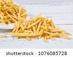 sticks of french fries on white ... | Shutterstock . vector #1076085728
