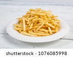 sticks of french fries on white ... | Shutterstock . vector #1076085998