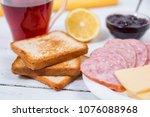 breakfast with tea  toasts ... | Shutterstock . vector #1076088968