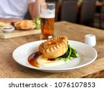 pie and mash with gravy  green... | Shutterstock . vector #1076107853