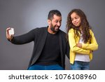 a black father taking selfie... | Shutterstock . vector #1076108960