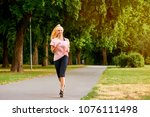 a beautiful young blonde woman... | Shutterstock . vector #1076111498