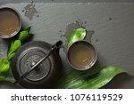 green tea on black slate plate. ... | Shutterstock . vector #1076119529