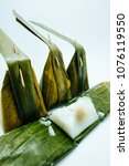 Small photo of Steamed Flour with Coconut Filling Dessert (Kanom Sai Sai ) Thai traditional dessert isolated on white background.