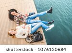 happy multiracial girlfriends... | Shutterstock . vector #1076120684